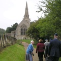 Nancy Braines greets us on our way to services at St James in Grafton Underwood.JPG