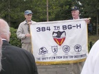Dave Lustig and Gene Goodrick hold the 384th banner at the monument.JPG