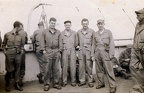 Charles on the right of the group of 4, aboard ship either to or from England. Can ayone ID the others