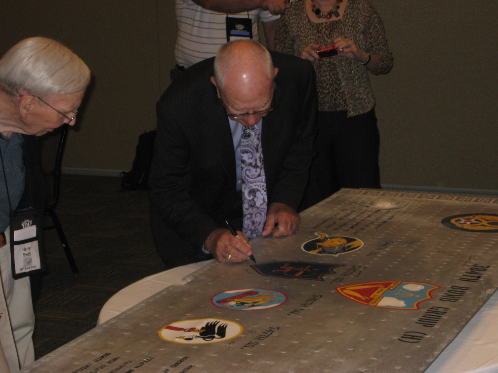 Don Hilliard signing the wing panel.