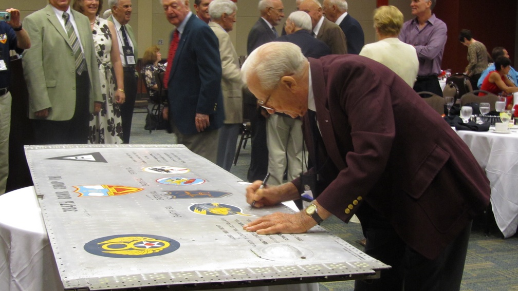 Jack Goetz signing the wing panel.