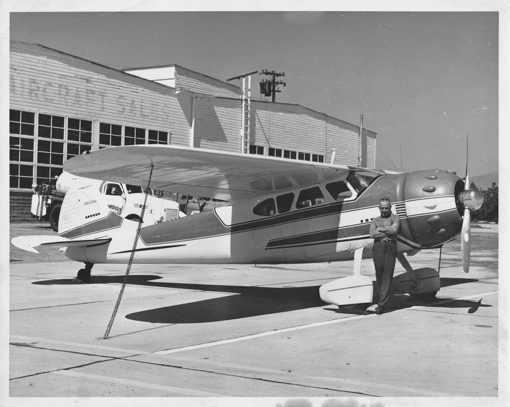 Budd Peaslee and Cessna 195, in front of Atwood Hangar.