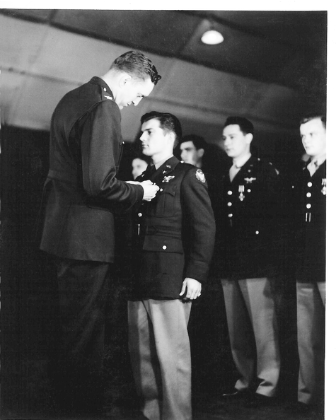 Russell M. Potts receiving the Distinguished Flying Cross from COL Dale O. SMith.png