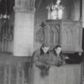 Two Men Praying in Church