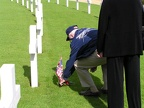 Gene Goodrick placing sprig and poppy at another 384th grave.JPG