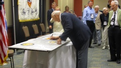 Henry Sienkiewicz signing the wing panel.