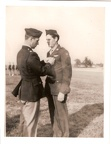 S/SGT Thomas P. Philbin receiving the Distinguished Flying Cross from LTC William E. Buck.