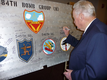Bill O'Leary signing the wing panel.