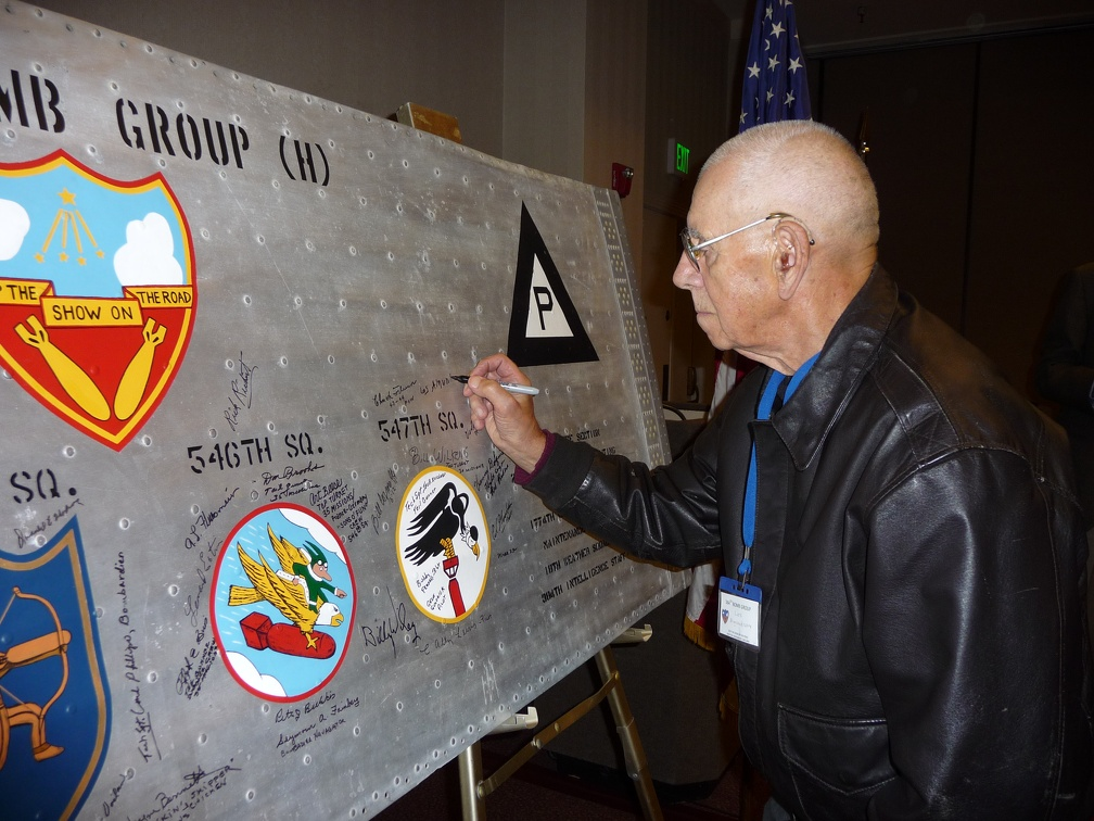 Les Amundson signing the wing panel.