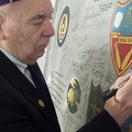 Adding his signature to the Commemorative Wing Panel
